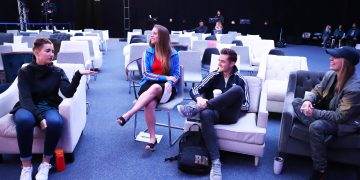 A group of people sitting in comfy chairs and talking with each other. Robbie Rogers_adidas_LGBTQ_Talk