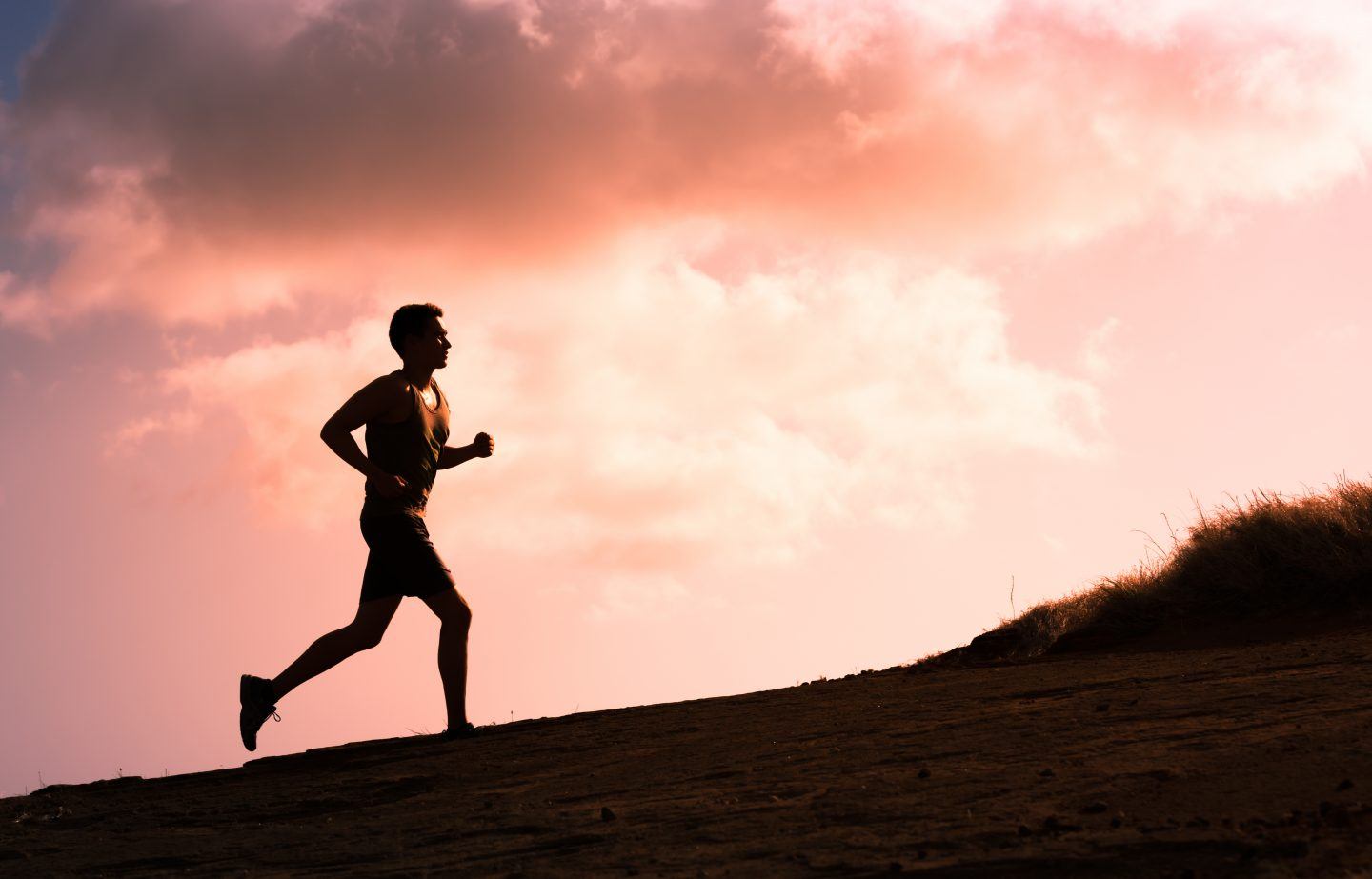 Man running outside in the sunrise to feel free