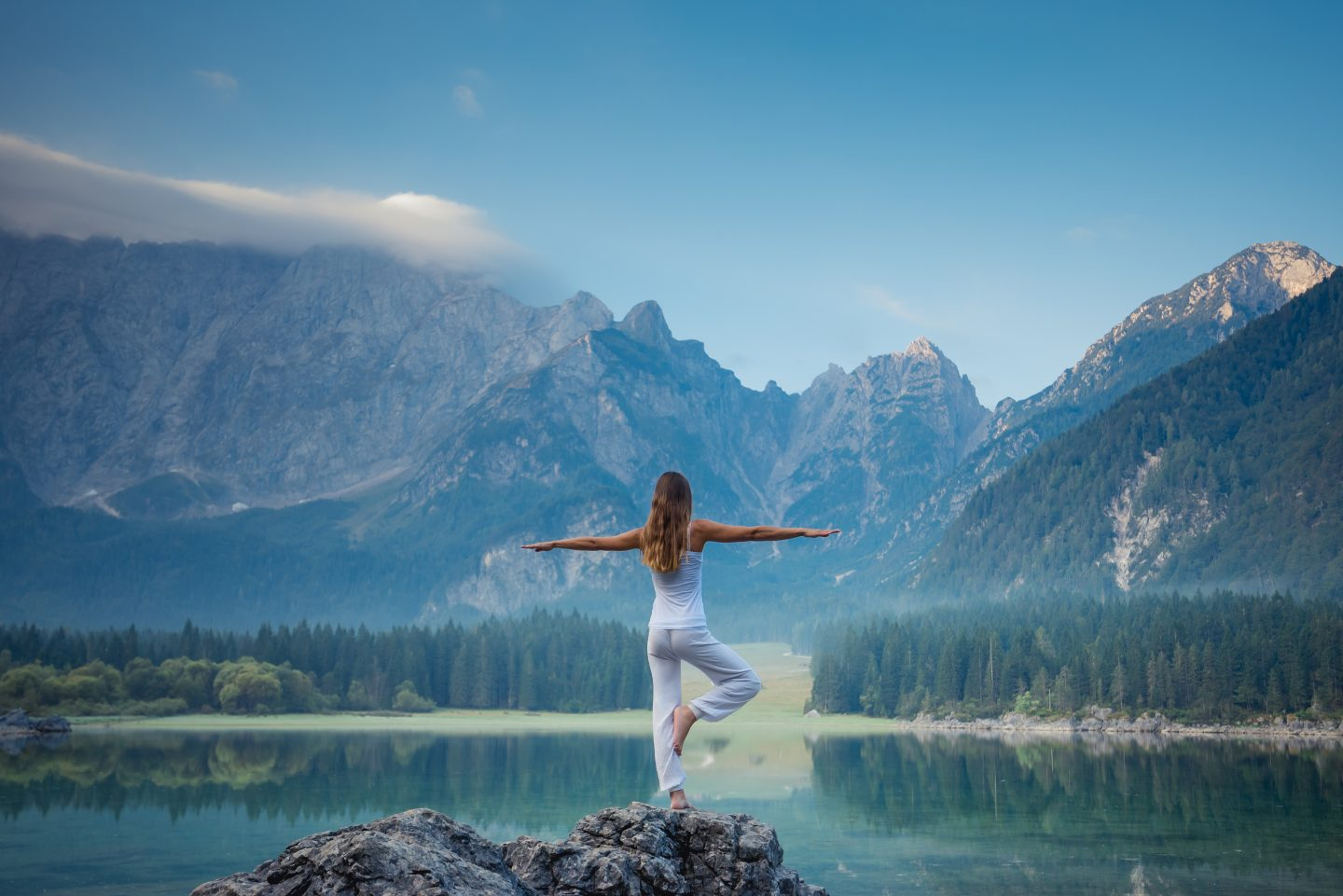 Young beautiful woman doing yoga exercises. Healthy lifestyle concept.