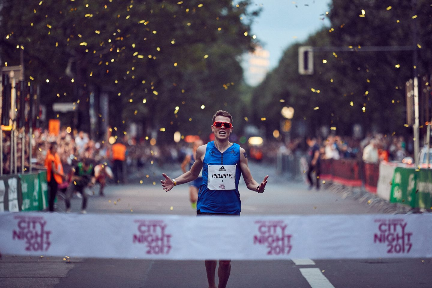 Marathon athlete crossing the finish line at adidas Runners City Night race in Berlin. Phillipp Pflieger_Marathon_Running, finish line, finisher, adidas, Berlin, Berlin Marathon, athlete, competition, setbacks, failure, self-improvement