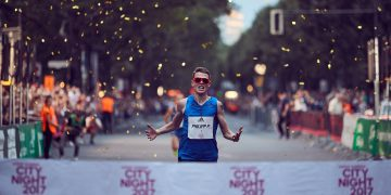 Marathon athlete crossing the finish line at adidas Runners City Night race in Berlin. Phillipp Pflieger_Marathon_Running, finish line, finisher, adidas, Berlin, Berlin Marathon, athlete, competition, setbacks, failure, self-improvement