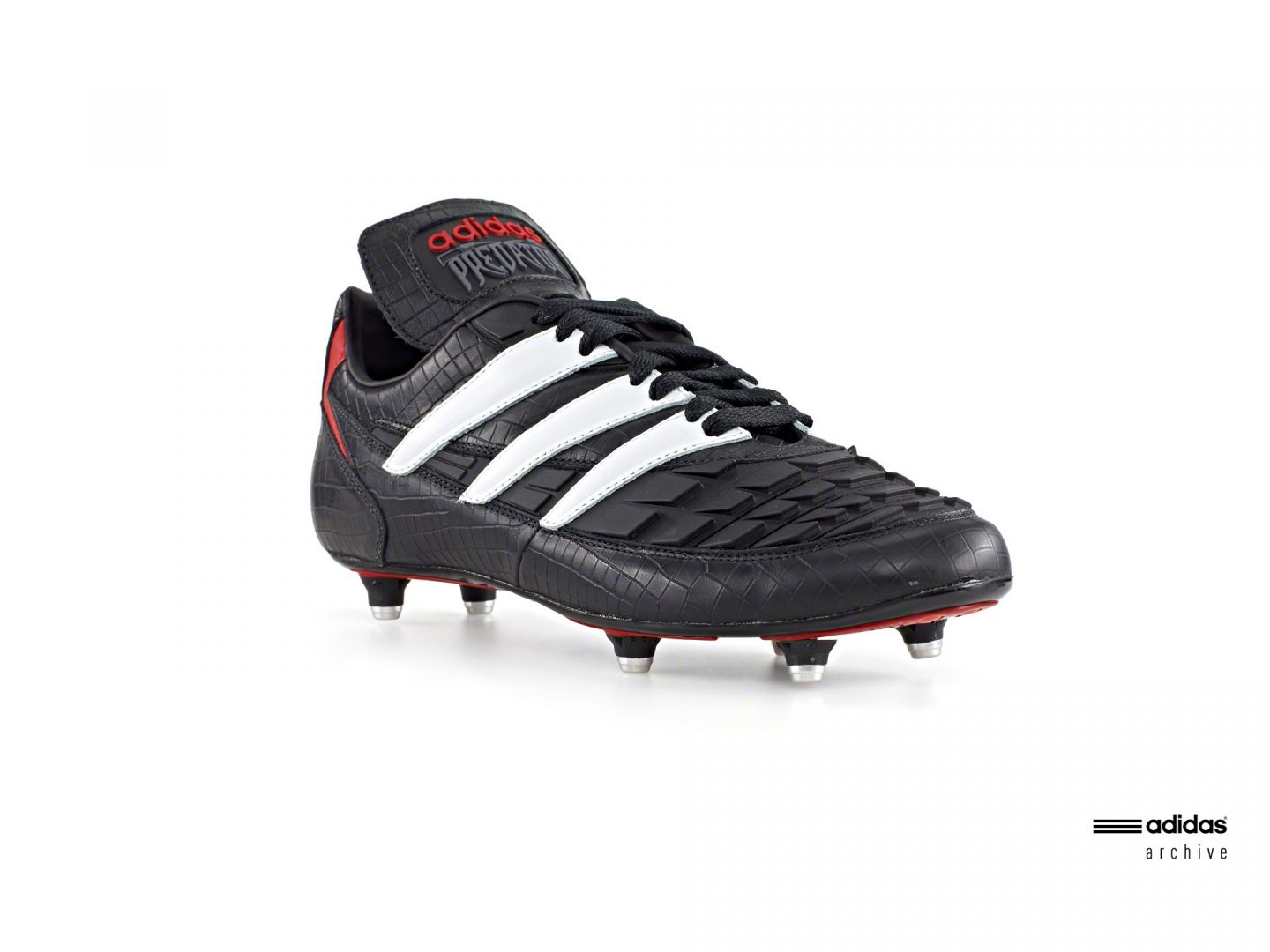 The black and white Predator boot with red details from 1995. aidas; Predator; football; Champions; Legend; Icon; soccer; GamePlan A