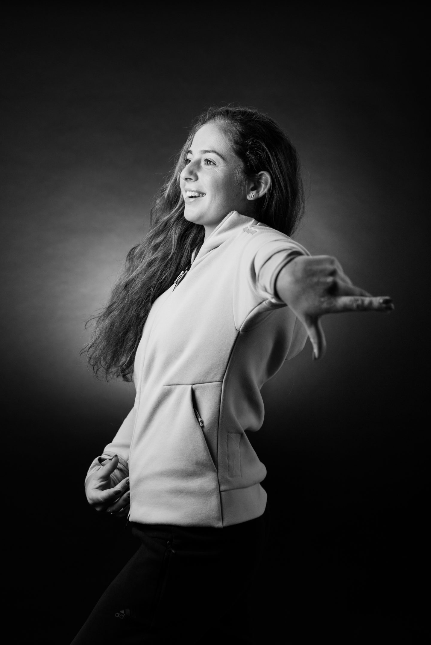 Jelena Ostapenko is turned to the left, smilingly pointing with her finger. Tennis; Adidas; Reebok; GamePlan A; Champion; Inspiration; Motivation; Grand Slam; Winner