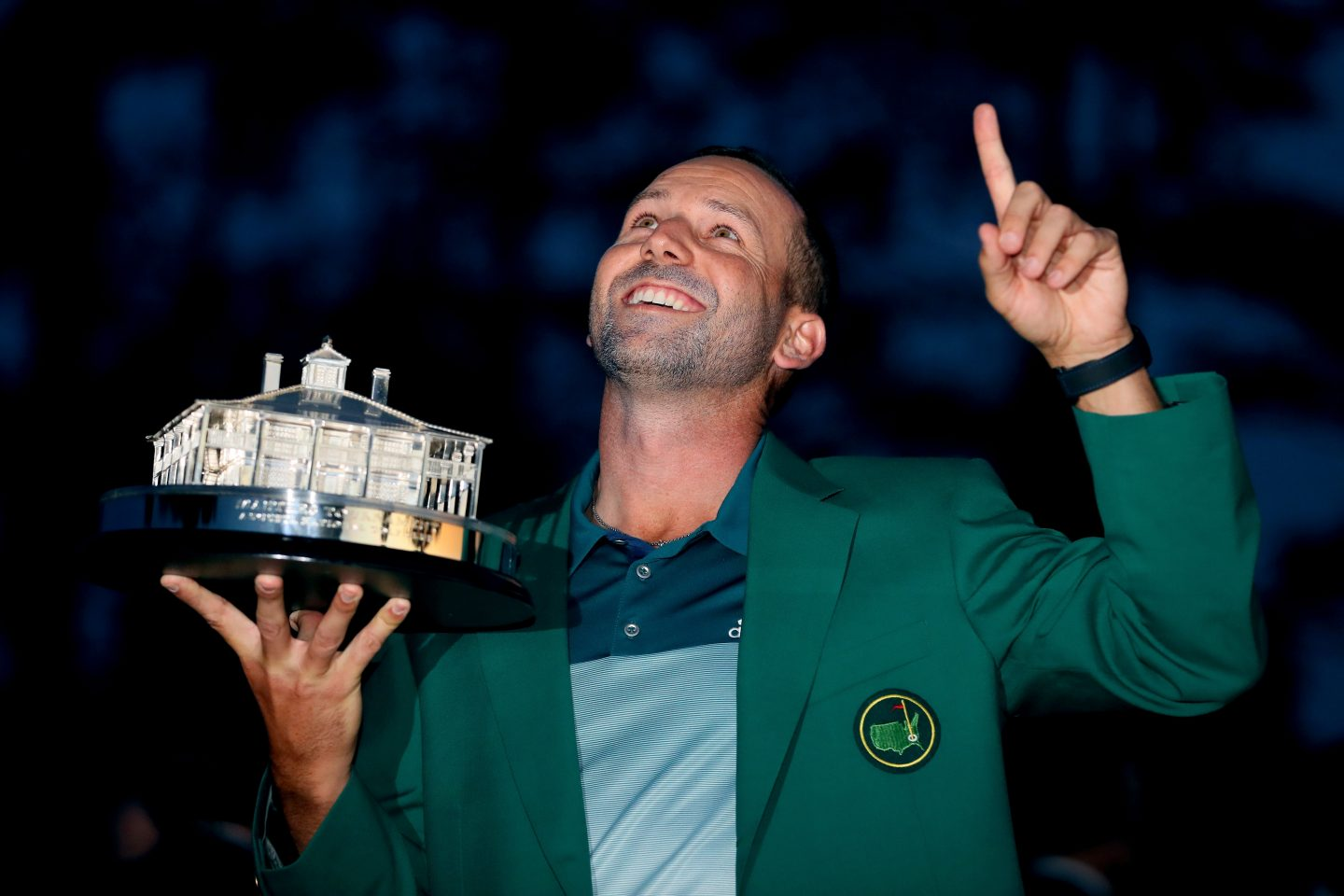 Golfer Sergio Garcia is holding a trophy and pointing one finger to the sky. Gold; Champion; Tournament; Golfer; Athlete; Adidas; Champion; Win; Motivation; Inspiration; Masters